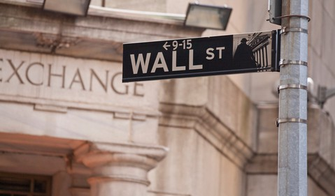 Wall Street sign in front of NYSE