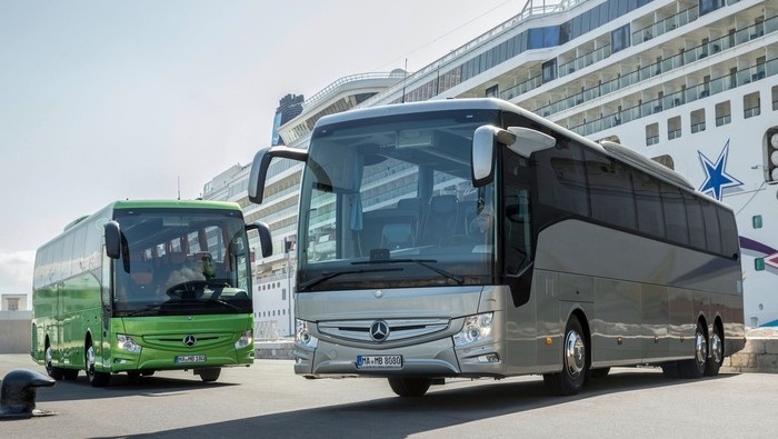 Two Mercedes-Benz buses.