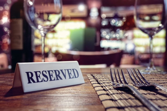 A reserved sign at a restaurant table