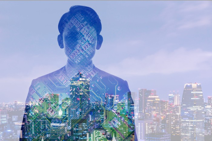 Image of man with computer motherboard superimposed on top, with city in background.