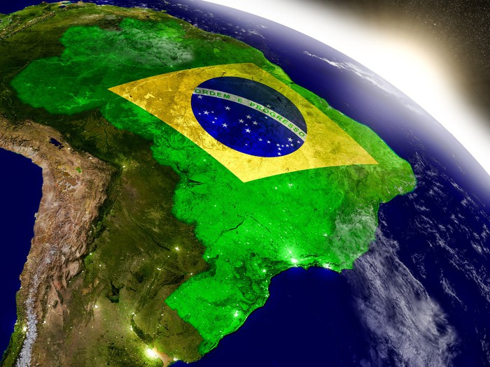 Brazilian flag superimposed over map of Brazil