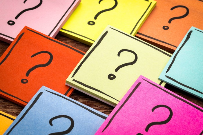 Colorful Post-It Notes with a question mark drawn on them.