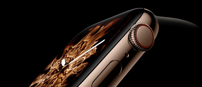 A gold Apple Watch displayed against a black background.