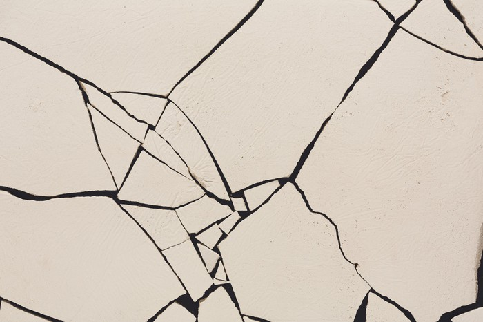 A surface riddled with cracks