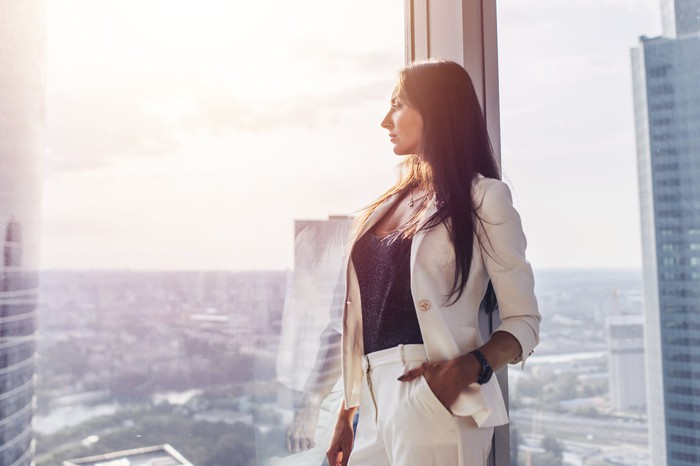 Woman in business suit looking out the window.