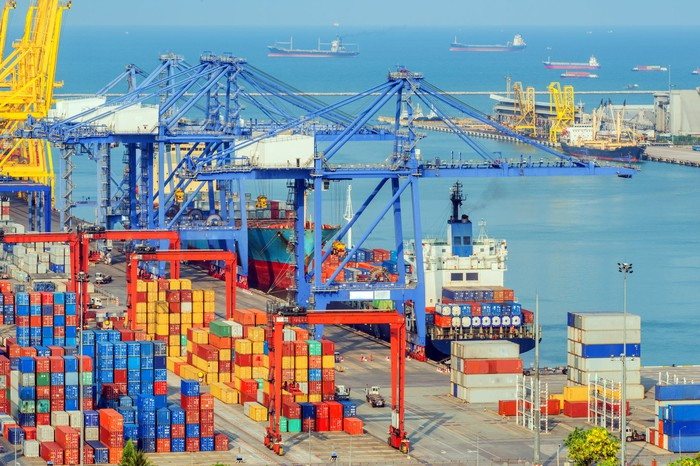 Containership by cranes at port