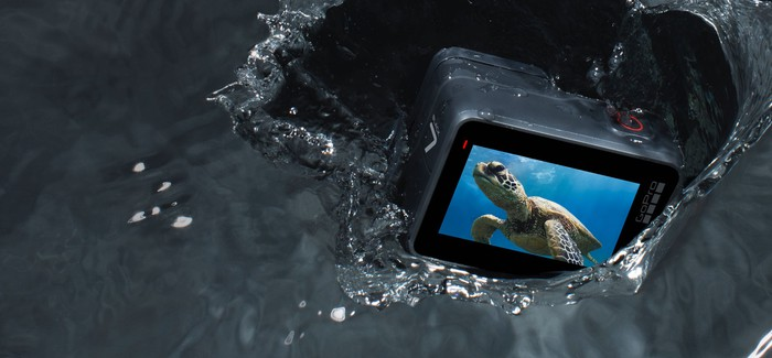 Snapshot of GoPro HERO7 camera falling into water with an image of a sea turtle on the display