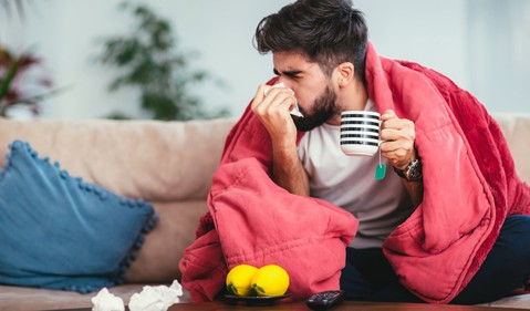 flu man with blanket GettyImages-924698666