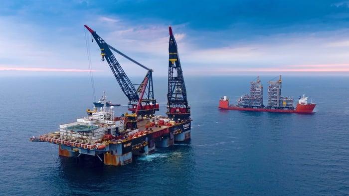 Installing topsides at an offshore oil platform.