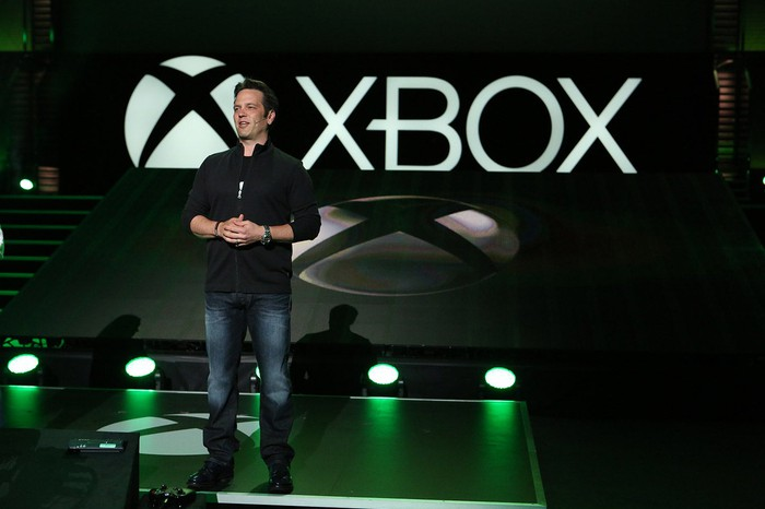 A man standing on stage at an Xbox media briefing.
