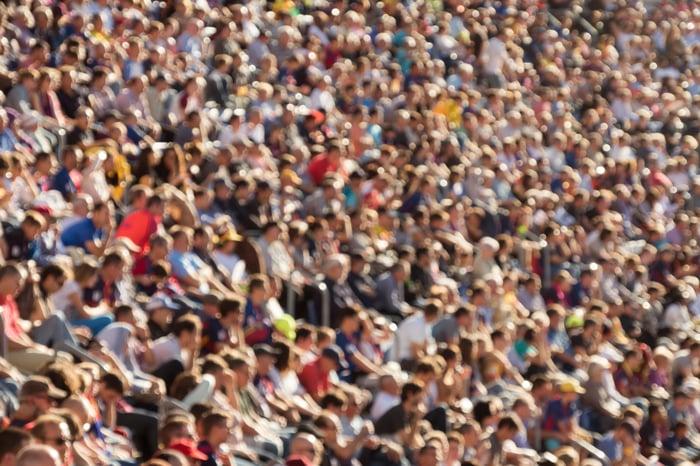 A blurred crowd in a sports stadium