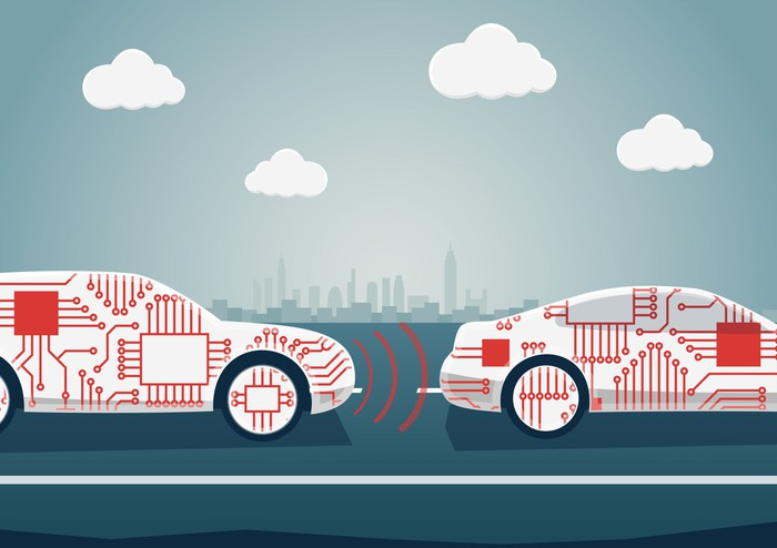 Graphic of two cars with computer chips on them driving on the road.