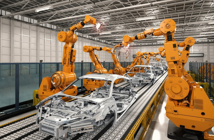 Robots manufacturing a vehicle frame