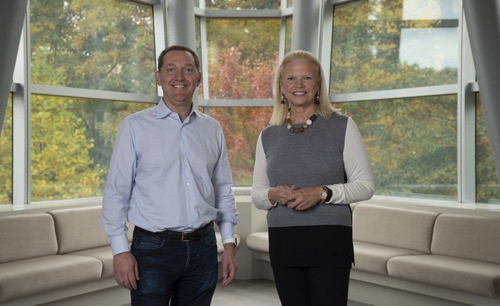 IBM CEO Ginni Rometty on the right and Red Hat CEO Jim Whitehurst on the left.