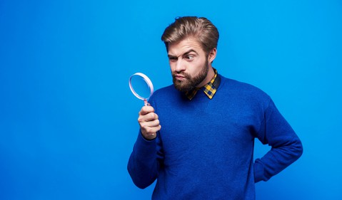 Getty Magnifying Glass with Bearded Man