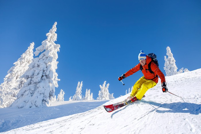 Man skiing down a snowy mountain.