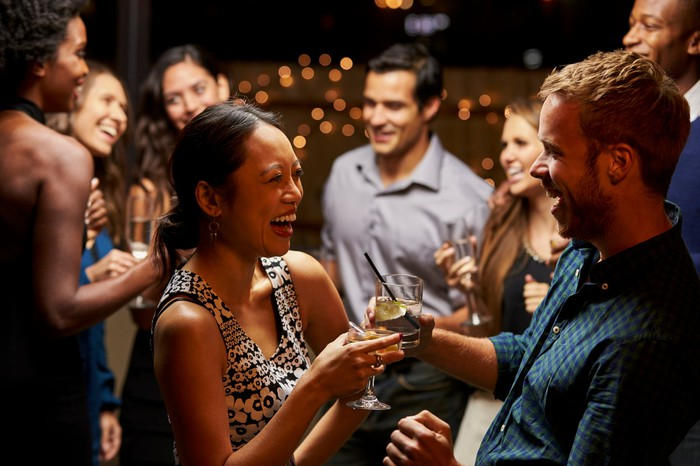 People mingle at a cocktail parrty.