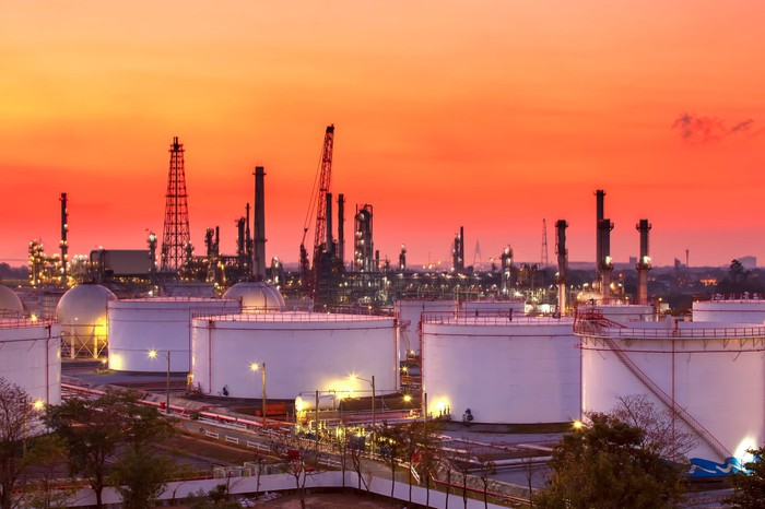 Refinery & oil storage tanks at sunset