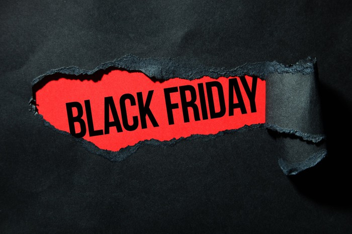 The words Black Friday in black letters against a red background, surrounded by all black.