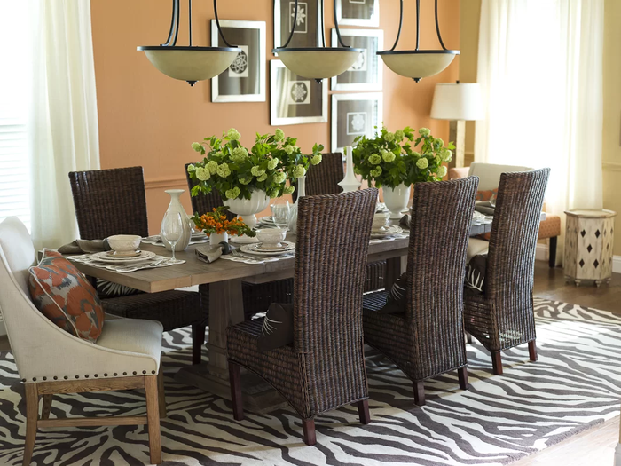 A dining room set with a table and six chairs.