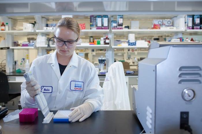 Scientist in a lab using a multi-channel pipette