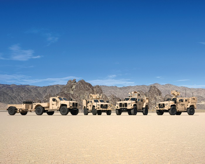 Oshkosh military trucks on display