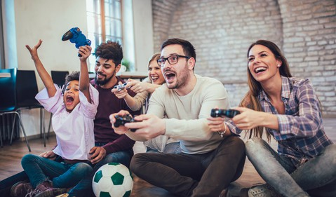 group of men and women playing video games