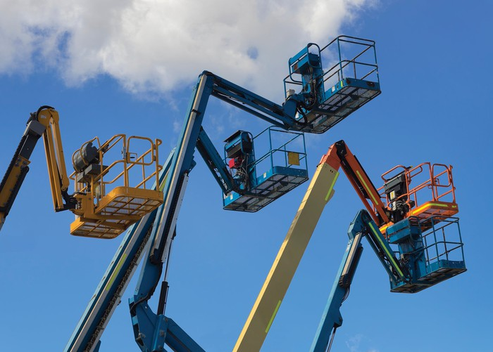 """The platforms of a group of aerial work platforms, or """"cherry pickers"""""""