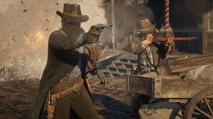 Two cowboys firing guns in front of an explosion.