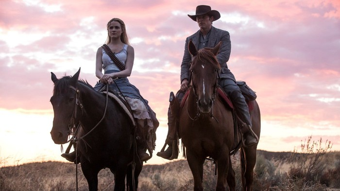A still from the series Westworld. A woman and a man sitting on horseback.