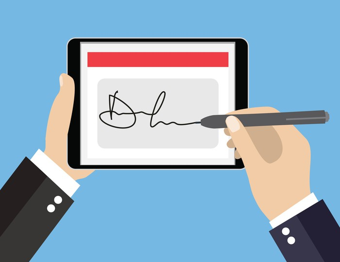 Cartoon of a businessman signing his name on a tablet