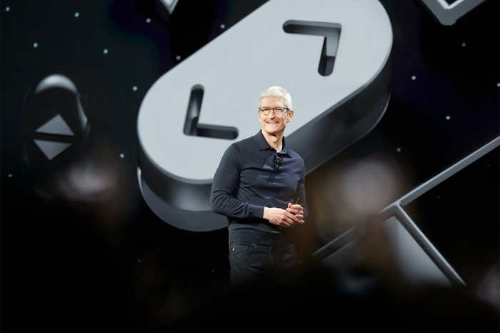 Apple CEO Tim Cook speaking onstage at WWDC 2018.