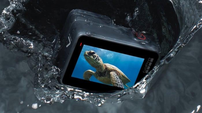 GoPro Hero 7 camera splashing on water.