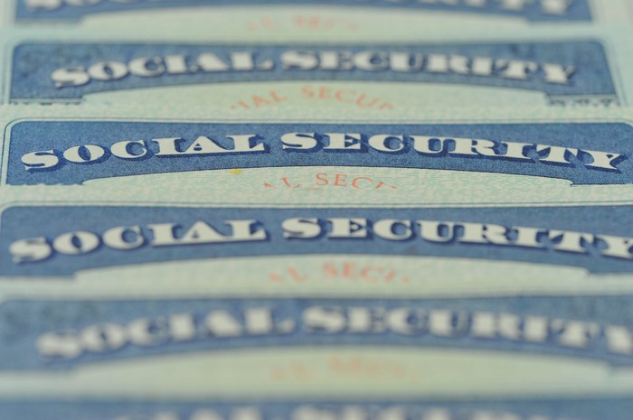 Social Security cards stacked on top of each other.