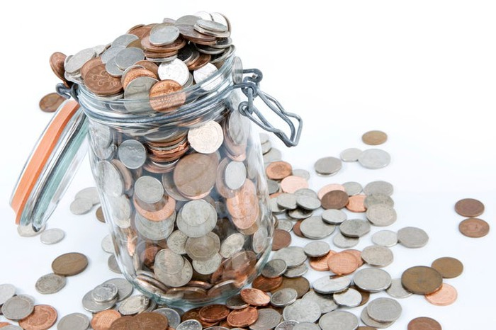A jar of coins overflowing.