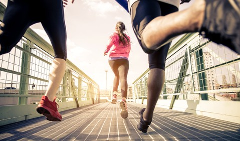 three young people running outdoors healthy jogging