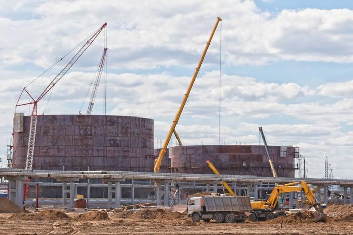 Petroleum storage tanks under construction.