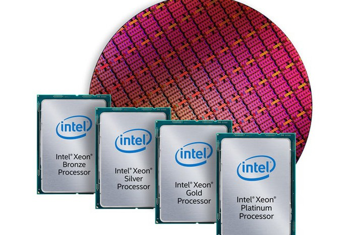 Intel Xeon Scalable chips in front of a wafer of Xeon Scalable chips.
