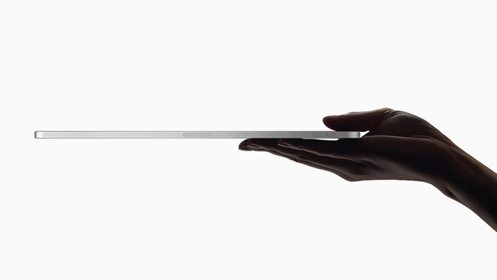 A hand holding an iPad Pro