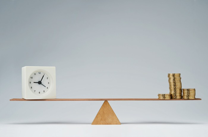 Seesaw balancing clock and coins