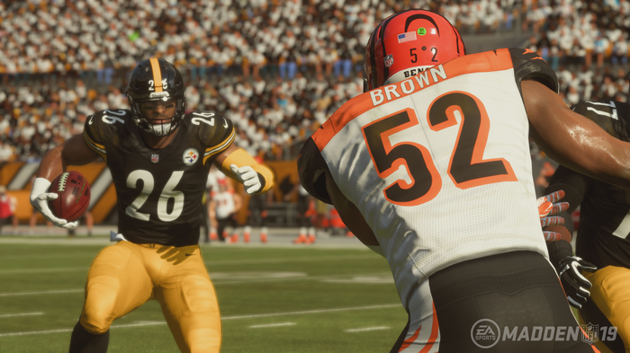 Screenshot of Madden NFL video game depicting two football players in action during a game.