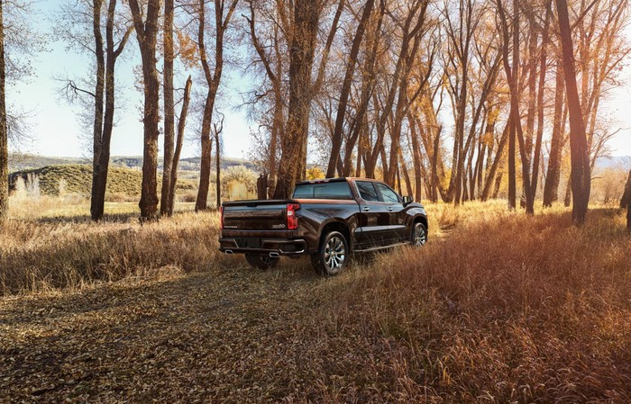 2019 Silverado High Country offroad surrounded by trees.
