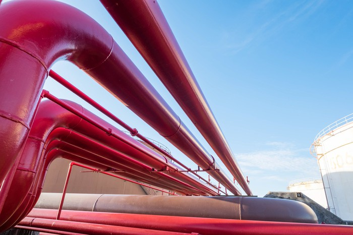 Red pipelines at an oil storage terminal.