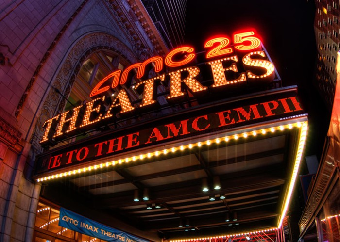 A lighted marquee outside an AMC theater.