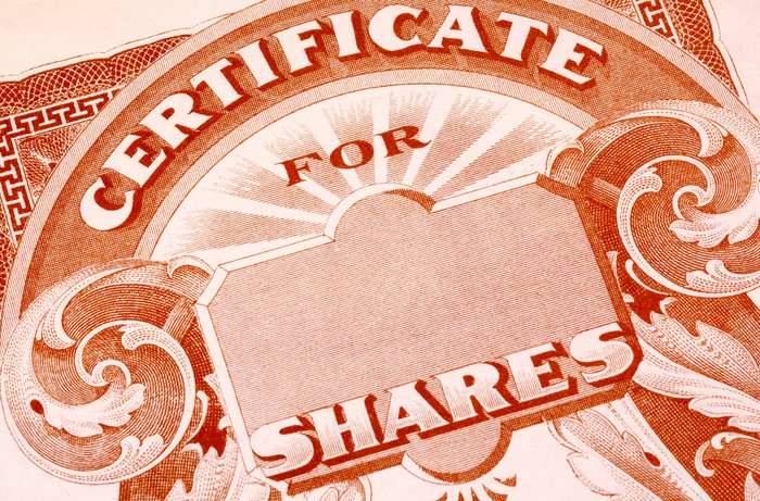 An up-close view of a paper stock certificate for publicly traded shares.