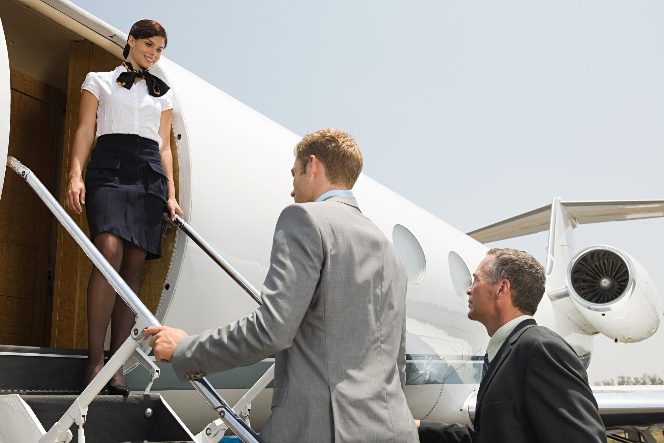 Passengers entering a business jet.