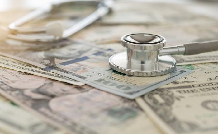 Stethoscope on top of money.