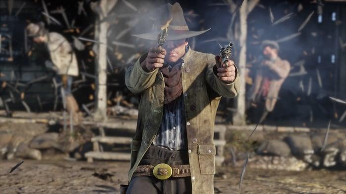 A cowboy firing two pistols at an unseen foe.
