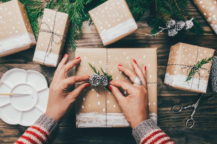 A woman wraps a gift.