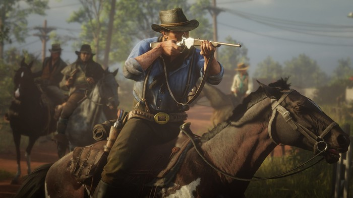A cowboy riding a horse and firing a rifle in Red Dead Redemption 2.